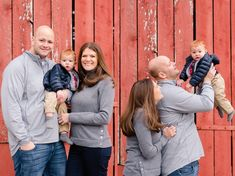 Simply Picturesque Photography | Calvert County Maryland Photographer | The perfect family of three! Family posed in front of red rustic barn while smiling and laughing with their baby boy. The perfect winter family photography session in Southern Maryland!!