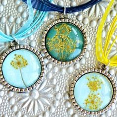 Learn how to make a dried flower pendant with pressed wildflowers.