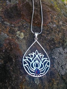 In Buddhist and Hindu cosmology, the lotus represents awakening, as the purity of the lotus and truth arises out of mud and illusion. Garnet is known as a powerful energizing and regenerative stone, that balances, strengthens and protects.  This necklace...