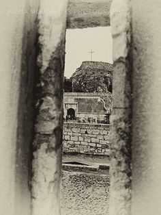 The old fort from an opening in the main wall. Corfu Greece, Old Fort, Black And White Photography, Old Things, Island, Wall, Artwork, Black White Photography, Work Of Art