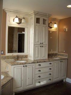 double sink vanity with center cabinet. Transitional  Bathrooms Dorothy Willetts Designers Portfolio HGTV Home Garden Television For the Pinterest bathroom