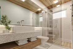 Nos banheiro utilizamos forro em madeira e um revestimento da Portobello que imita tijolinho aparente para dar mais aconchego aos ambientes