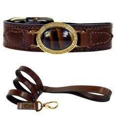 An elegant Italian leather dog collar featuring a tiger eye gemstone with Swarovski Crystals.