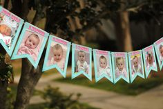 First birthday party picture bunting...made mine in Photoshop, printed as 4x6 prints and strung with ribbon.  CUTE!