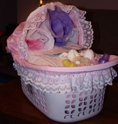 Laundry Basket Bassinet Tutorial:  Laundry baskets decorated to look like baby bassinets then filled with baby shower gifts.  |  by metria at Craftster.org