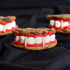 Dracula's Dentures for Halloween How-To ~ using chocolate chip cookies, vanilla frosting tinted red, miniature marshmallows, slivered almonds