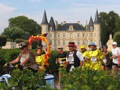 """Run and Taste Your Way Through 26 Miles of Vineyards- Bordeaux, France  Join Marathon Tours & Travel for a 26.2-mile run through 59 vineyards in the fabled villages of the Medoc region of Bordeaux, France. The Marathon du Medoc takes you through dozens of the areas best vineyards and chateaus, tasting wine along the way. To add another layer of fun to this jubilant race, each year has a different """"theme"""" and the majority of entrants dress up accordingly."""