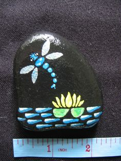 DragonFly and Lily - painted stone Dragonfly Painting, Pebble Painting, Pebble Art, Stone Painting, Stone Crafts, Rock Crafts, Hand Painted Rocks, Painted Pebbles, Painted Stones