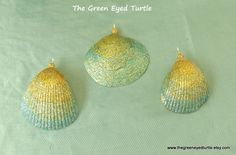 This is a set of 3 sea shells that I embellished with gold and teal glitter to give them a great ombre effect. I attached a wire loop for ease of hanging. These would be a great addition to your coastal holiday tree or wreath. They could even hang from a chain or cord as a stunning necklace. NOTE: This is a made to order item. Shell type and size will vary from the picture shown.