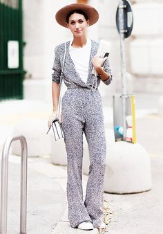 Medium-brim fedora, printed flared jumpsuit and white sneakers