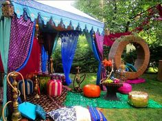 outdoor boho gypsy tent, I like the tassel and sun accents!