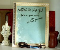 Dry erase board out of a picture frame. Pretty paper under the glass- embellish the frame, tie on a marker!