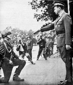 An enlisted soldier of the Polish People's Army gets promoted to commissioned officer by the Defense Minister gen. Wojciech Jaruzelski, 1970.