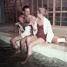 Grace Kelly and William Holden on the set of The Bridges at Toko-Ri