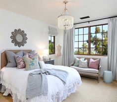 bedroom with white beaded chandelier