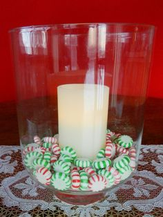candle and peppermints in a hurricane vase