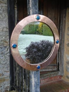 A lovely Arts & Crafts round copper mirror with four deep blue Ruskin cabochons. These were retailed by Liberty & Co but this one bears no label. Offered in excellent condition with original back and mirror plate. Antiques Atlas #artsandcraftsmirror #libertymirror #cabochon #antiquemirror #periodhome Mirror Plates, Round Mirrors, Copper Mirror, Looking To Buy, Antique Copper, Deep Blue, Metal Working, Liberty, Arts And Crafts