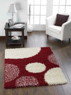 One of our beautiful shaggy rugs_ Pluto Red Shaggy Rug has a beautiful colour theme with cosy thick pile content.