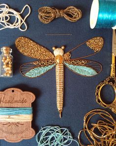 Best 12 Bedford, England-based embroidery artist Humayrah Bint Altaf (previously) continues to construct ornate insects using shimmering threads and metallic beads. Her dragonflies, bees, beetles, and butterflies take shape using carefully paired patterns Tambour Embroidery, Bead Embroidery Patterns, Bead Embroidery Jewelry, Hand Embroidery Stitches, Embroidery Fashion, Hand Embroidery Designs, Embroidery Techniques, Beaded Embroidery, Beaded Jewelry