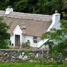 This lovely Irish cottage with its stunning patterned thatched roof is located on Loch Eske in County Donegal, Ireland. It is dedicated to a Flickr friend whose grandmother once lived here.