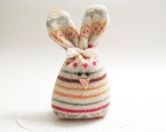 A great addition to your Easter or spring table display, sitting on the counter or a shelf, or keeping you company at your desk.  -:¦:- DESCRIPTION -:¦:- This cutie is constructed from a hot pink felted wool sweater. She has two black bead eyes and a cute little pink nose. She has a white ribbon and her little bunny tail is an off-white felted wool ball. Rosebud is stylin in her flower crown or carrot bouquet - optional additions you can choose at checkout! If you want your flower(s) to be a…