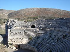 Part of the ruined Amphitheatre at Patara in Turkey.The Amphitheatre was built in the reign of Antoninus Pius; its diameter is 265 feet, and has about 30 rows of seats.