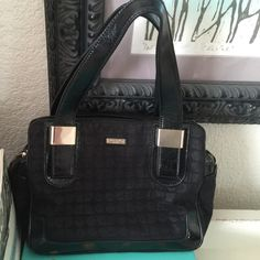 Kate Spade Handbag Kate Spade small black handbag. Leather handles and accents. Three storage compartments. Middle compartment zips up. 10x7.5 Very minor wear and tear on the leather and metal plate parts of the bag. 8 years old, lightly used through the years. Classic, boxy Kate Spade look. Feel free to make an offer! kate spade Bags Mini Bags