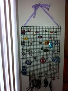 DIY earring holder using ribbon and cooling rack.