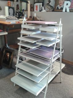 Use a clothes drying rack (Debb Bates made this) to dry your different size canvases, after you prime and paint them !! Works great !!