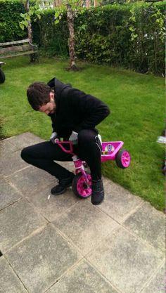 Jamie Dornan, driving his daughter's PINK bike!