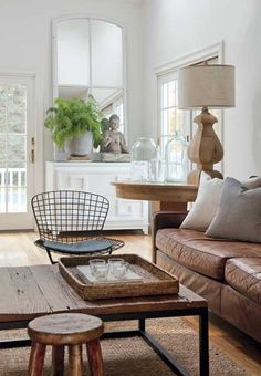 We love the calming mix of white and earth tones in this comfortable family room. --Photo Credit: Eric Roth