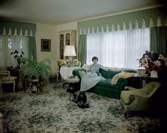 """What a """"Babe"""". The floral carpet and green and yellow tones of the fabric create an indoor garden scheme, as Mrs. William Paley, aka Babe, lounges on a tufted sofa Vogue, June 1948 Villa Interior, Interior Design, Interior Decorating, Decorating Ideas, Vogue Photo, Babe, Built In Furniture, Arrange Furniture, Layout"""