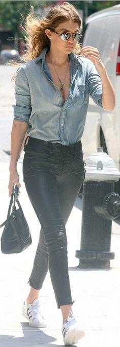 Who made  Gigi Hadid's black leather lace up pants, denim print shirt, white sneakers, sunglasses, and black handbag?