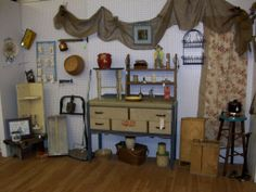 Memory Furniture Finds now operates two booths at Black Diamond Antiques and Collectibles.  This is the primitive, farm, and industrial booth.  Here are the tools, implements, and containers that give your décor a rustic country look.