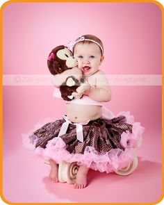 Birthday girl with her little monkey!  This sweet girl is wearing one of our mini-pettiskirts.
