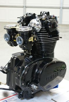 Blacked out XS650 engine with polished fins.
