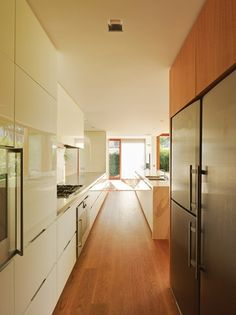 I like the clean look and lots of kitchen storage. I hope it is well organized inside. See Storage board.