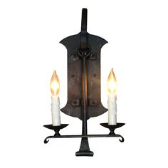 made for a castle? wrought iron wall sconce with 2 candelabra bulbs. Made by Texas Lightsmith