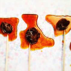 traditional Chinese Preserved Plum Caramel Lollipops-dried sour plum encased lovingly in hardened caramel, sweet and sour coming together in your mouth Candy Recipes, Dessert Recipes, Sour Plum, Chinese Food, Chinese Desserts, Turkish Delight, Fortune Cookie, Sorbet, Preserves