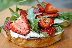 Marinate sliced strawberries in balsamic with salt & pepper...arugula & soft cheese of your choice on grilled bread.