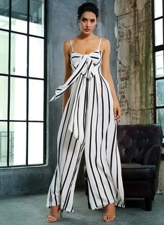 Simple and chic is our black and white striped jumpsuit with bow front spaghetti straps top and wide leg pants. African Fashion Designers, African Men Fashion, Africa Fashion, African Wear, Womens Fashion, Casual Chique, Casual Wear, Fashion Advice, Fashion Outfits
