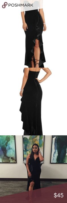 Black Strapless Dress This long black velvet dress has a slit that is decorated with ruffles. It has a very deep V which calls for pasties and sticky tape instead of a regular bra. It is NOT at all tailored. I'm 5'2 and the heels are 3in high. Windsor Dresses Strapless