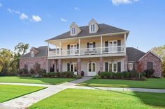 This gorgeous Baton Rogue home is the picture-perfect example of southern charm!