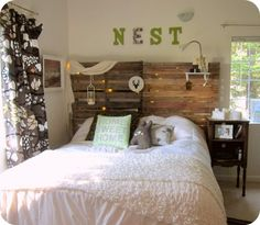 I've been trying to decided if I want to do a fabric headboard or something like this-loving this!