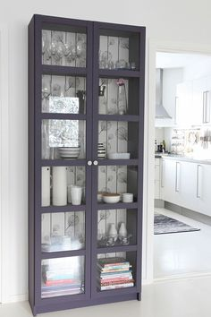 What a great way to brighten up a dark china cabinet!