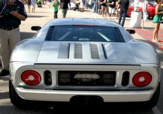 No one ever shows you the rear view of a 2005 Ford GT supercar, why is that?  So we took this photo at Barrett Jackson Palm Beach, showing a simple muscle design. You're welcome. This was $150,000 when built, but it sold for $220,000 at the auction, plus a 10% buyers premium.  #ford #fordgt #2005fordgt #barrettjackson #barrettjacksonpalmbeach Barrett Jackson Auction, Ford Gt, Rear View, Supercar, Palm Beach, Cool Cars, Muscle, Simple, Building