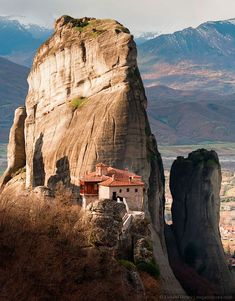 Closer photo of Meteora in Greece, a grouping of tall rock formations where monasteries have been built.   - photo by Evgeni Dinev