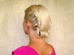 Retro rolled updo with lace braids Vintage hairstyle for medium to long hair.  Watch as she styles her own hair in 3:30 mins.