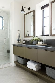bathroom with olive green cabinets and dark countertops and limestone herringbone floors. Beach House Bathroom, Bathroom Sets, Paint Bathroom, Small Bathroom, Downstairs Bathroom, Bathroom Storage, Modern Bathroom, Chic Bathrooms, Contemporary Bathrooms