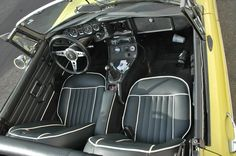 OLD PARKED CARS.: 1970 MG MGB.
